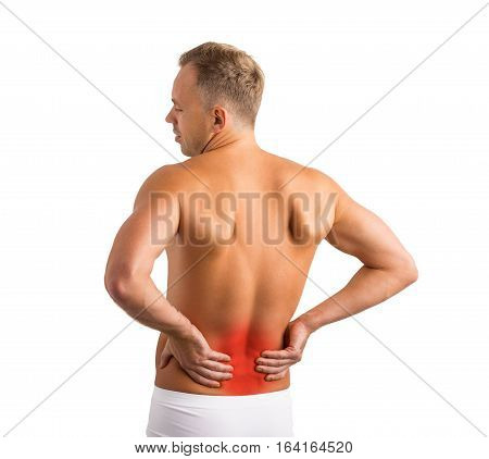 man having back pain in his lower back
