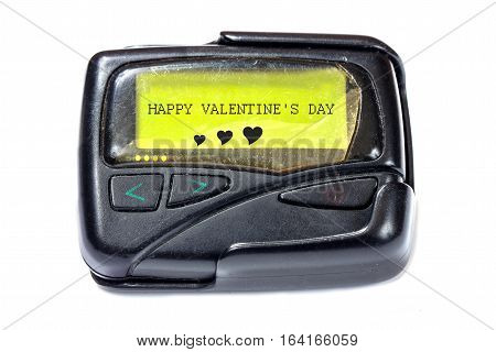Old pager on a white background. The message on the screen: Happy Valentine's Day