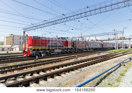 Nizhny Tagil Russia - May 21 2016: Shunting diesel locomotive with passenger cars railway junction