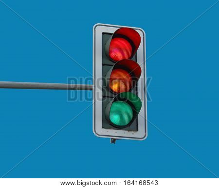 At a traffic light the three colors light up red, yellow and green at the same time.