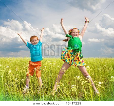 Two golden-haired children playin the field
