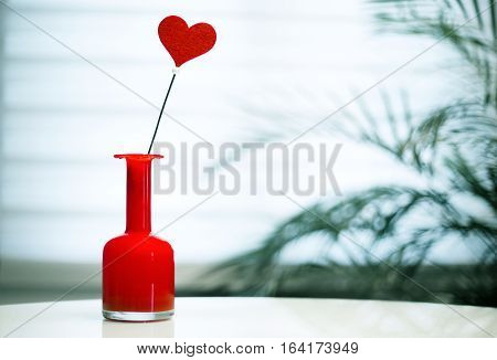 valentine´s day background with a heart in a flower vase