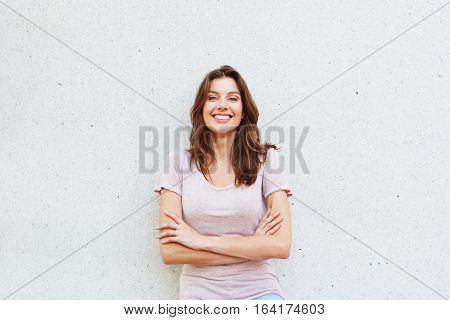 Attractive Young Woman Smiling Against White Wall