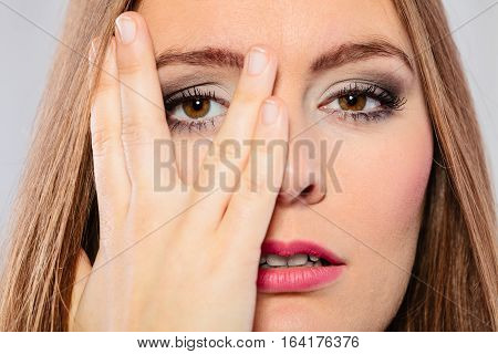 Woman Cover Face Look Through Fingers.