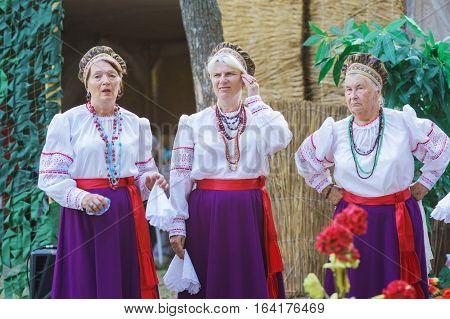 SLAVYANSK-ON-KUBAN RUSSIA - JULY 31.2015: Cossacks sing at a village fete