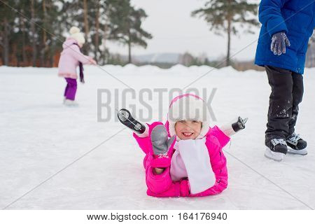 Young Skater Girl Lying On The Ice