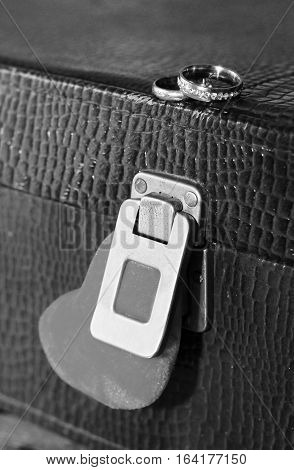 Red heart and a suitcase lock and wedding rings
