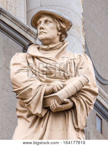 Marble statue of the german reformer Martin Luther in front of a church in Copenhagen