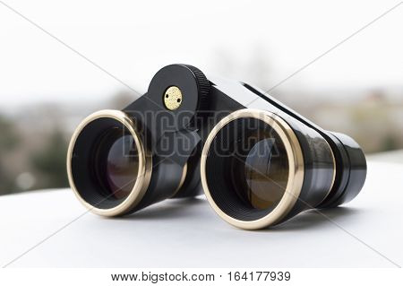 Old opera glasses on the white background