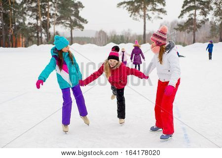 Three Attractive Skater Girl On The Ice