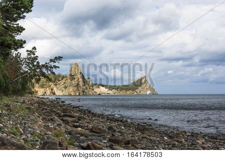 The coast of lake Baikal has a lot of rocky bays, surrounded by steep cliffs.