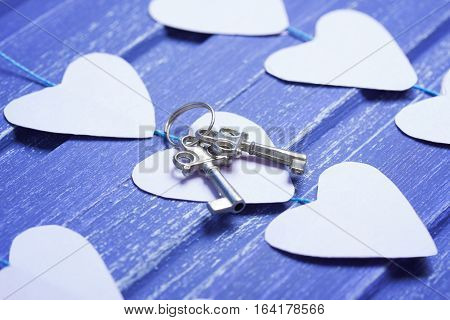 Paper Hearts And Silver Keys On Purple Wooden Background
