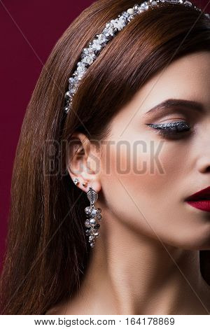 Fashion portrait of a beautiful girl. With the Hoop on the head in the form of spikes