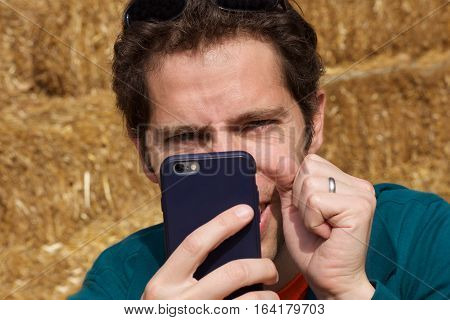 Handsome young man using smart phone to take photo