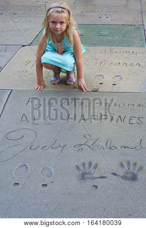 July 31, 2016: young girl with Judy Garland handprints and footprints