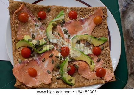 Crepe filled with Tomatoes, avocado , smoked salmon lox, brie cheese and pumpkin seeds