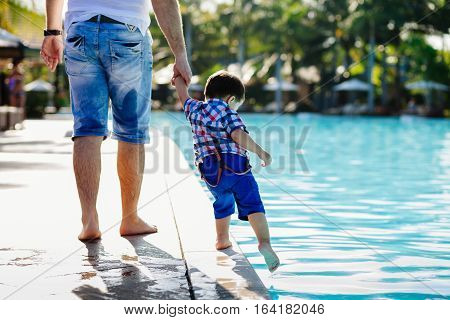 family vacation on luxury beach resort. Swimming pool