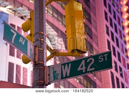 Street sign for 7th Avenue and West 42nd St. in New York City