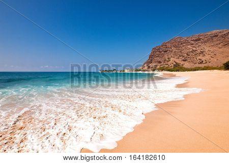 Wide angle view of Makaha Beach, the original surfing beach, on the northwest coast of Oahu, Hawaii