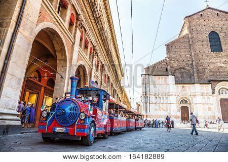 Bologna, Italy - May 28, 2016: Perspective view of San Luca Espress, an tourist line which connects the historic center with the Basilica of San Luca, at side of Palazzo dei Banchi in Piazza Maggiore.