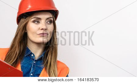 Woman Engineer Construction Builder In Helmet.