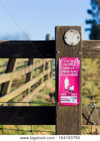 Finmere Oxfordshire United Kingdom January 05 2017: Public footpath marking on fence with purple warning 'Your dog can KILL livestock - please keep it on a LEAD' part of the initiative for Farmer calls for change to dog microchipping law.