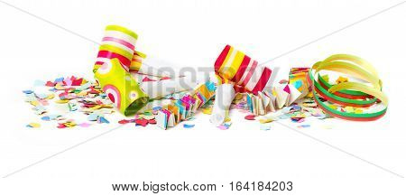 Carnival air snakes and confetti on white background