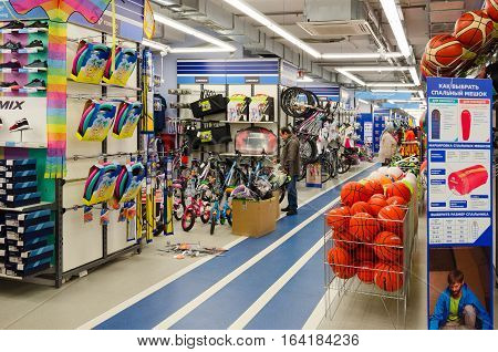 MOGILEV BELARUS - SEPTEMBER 28 2016: Unidentified people choose items for outdoor activities in sporting goods store