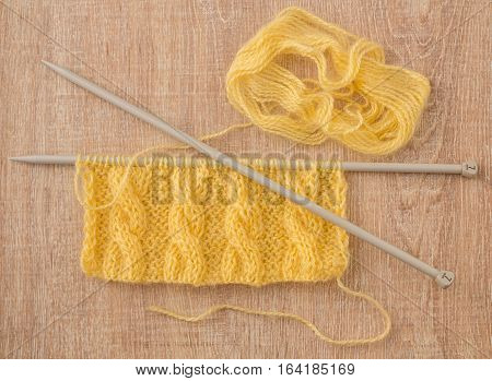 knitted scarf with cable pattern - yellow mohair
