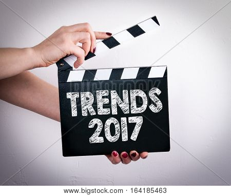 Trends 2017. Female hands holding movie clapper