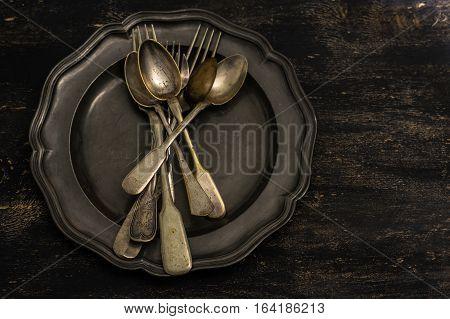 Vintage Silverware On Rustic Wooden Table