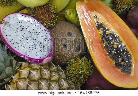 Background of many different fresh exotic fruits.