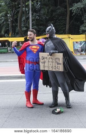 Sao Paulo Brazil March 6 2016: Two unidentified men with superhero costume at Paulista Avenue asking for money in Sao Paulo Brazil.