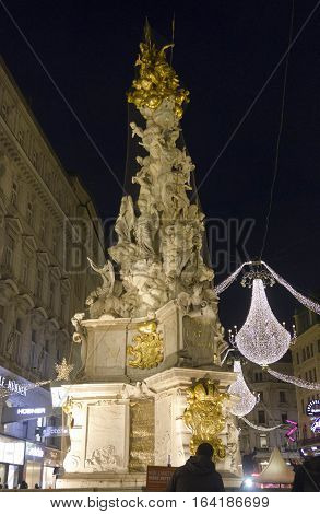 VIENNA, AUSTRIA - JANUARY 1 2016: Night view of Graben street in Vienna during Christmas time with Pestsaule memorial column in the foreground