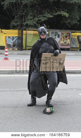 Sao Paulo Brazil March 6 2016: An unidentified man with superhero costume at Paulista Avenue asking for money in Sao Paulo Brazil.