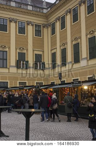 VIENNA, AUSTRIA - JANUARY 2 2016: Christmas market in the forecourt of Schonbrunn palace with people around in day time