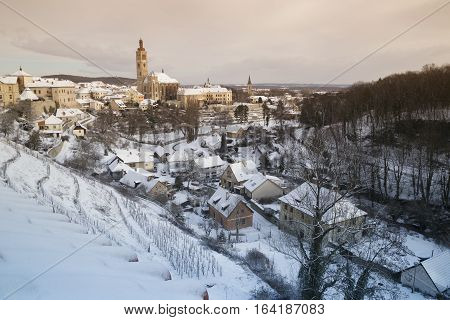 View on town Kutna Hora in winter St. James church snow Czech republic