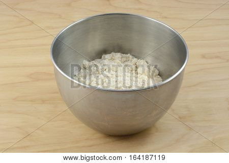 Packaged dry cookie or cake mix in stainless steel mixing bowl