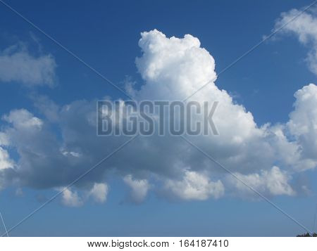White fluffy cloud in the blue Caribbean sky