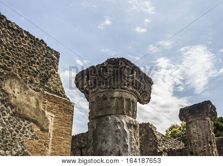 Ancient column, Corinthian order in Pompeii  city destroyed in 79BC by the eruption of Mount Vesuvius. The antique ruins and the vulcano near Naples, Italy poster