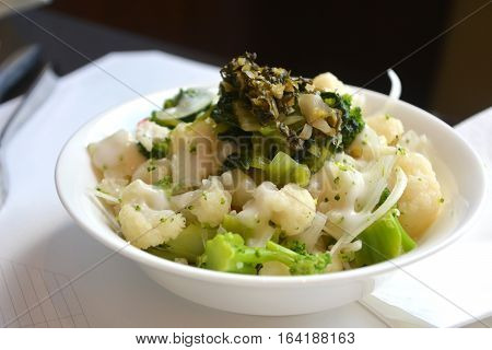 Japanese delicious meal on a bowl. Wasabi and vegetables.