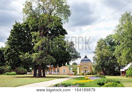 TARKHANI RUSSIA - AUGUST 28 2016: General view at the manor house church and oak in the Lermontov estate Tarkhani