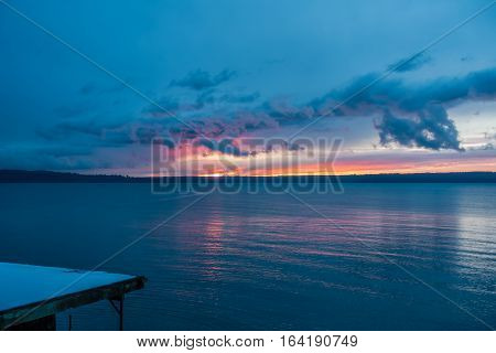 The sun sets behind the Puget Sound in winter.