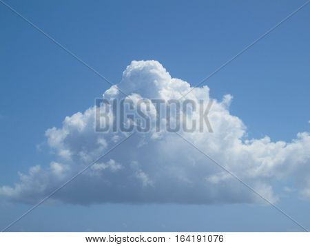 White fluffy clound floating in a blue Caribbean sky