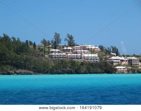 Carribean shore line with beach houses and apartments