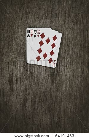 playing cards. four tens on a wooden table. concept of gambling and place for your text