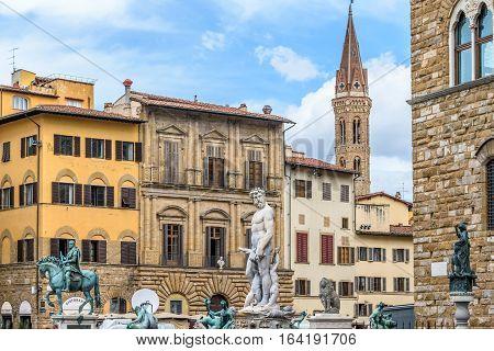 Piazza della Signoria. Neptune statue. Cosimo monument. Palazzo Vecchio. Florence, Italy.