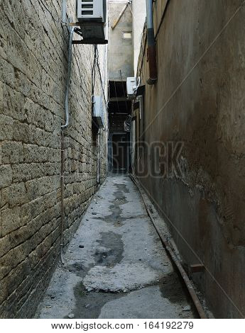 Narrow street in the old town of the city