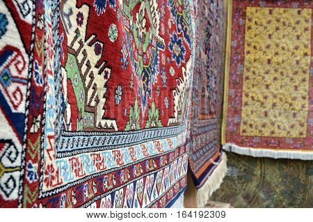 Oriental hand made carpets on the fair