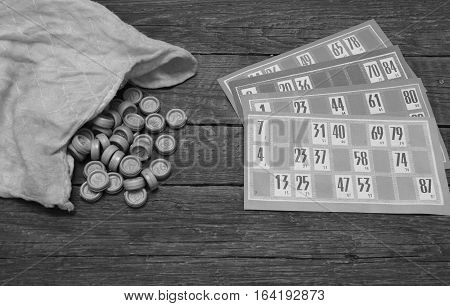 Lotto game cards and pieces in black&white colors